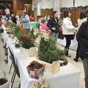 2017 - Woman purchased Christmas wreath at Bayberry Fair.